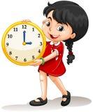 Girl holding yellow clock Stock Image