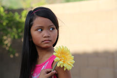 Girl Holding Yellow Flower Stock Photo