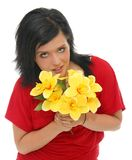 Girl holding yellow flowers Royalty Free Stock Photos