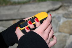 Girl holding yellow GPS navigation Royalty Free Stock Images