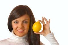 Girl holding yellow lemon Royalty Free Stock Image