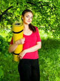 Girl holding yellow sport  and going to the yoga class Royalty Free Stock Images