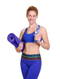 girl holding yoga mat and a bottle of water Stock Photography