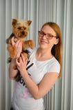 Girl holding Yorky dog Royalty Free Stock Image