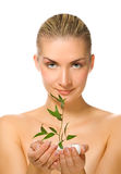 Girl holding young plant stock image