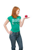 The girl holds an apple in palms. The image of the girl holding an apple Royalty Free Stock Photo