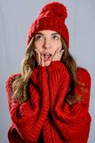 The portrait of the girl wearing red sweater and knitted hat stock image