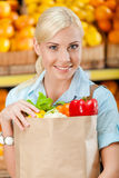 Girl holds bag with fresh vegetables Stock Photos