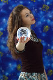 Girl holds a ball Royalty Free Stock Images