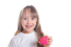 The girl holds a ball in hand and smiles Stock Photos