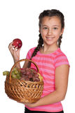 Girl holds a basket with vegetables Stock Image