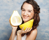 Girl holds in really big citrus fruit - pamelo, Royalty Free Stock Image
