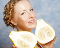 Girl holds in really big citrus fruit - pamelo, Stock Photos