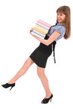 Girl holds the big pile of books Stock Photography