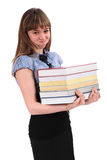 Girl holds the big pile of books. Has inflated cheeks royalty free stock photos