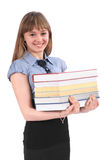 Girl holds the big pile of books stock photo
