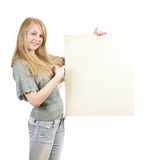 Girl holds blank canvas Royalty Free Stock Photos