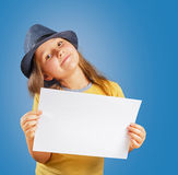 Girl holds blank paper, copyspace Royalty Free Stock Image