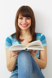 Girl holds a book Royalty Free Stock Photos