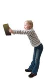 Girl holds book in outstretched arms Royalty Free Stock Photography