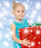 The girl holds the box Stock Image