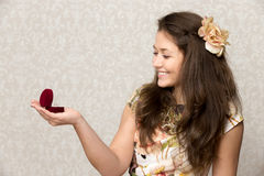 Girl holds box with ring Stock Photos