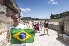 Girl holds the Brazilian flag for the next Olympics at Olympia b Royalty Free Stock Images