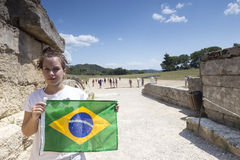 Girl holds the Brazilian flag for the next Olympics at Olympia b Stock Images