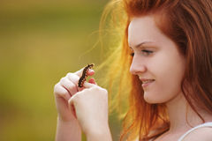 Girl holds brown caterpillar on her hand Royalty Free Stock Photo