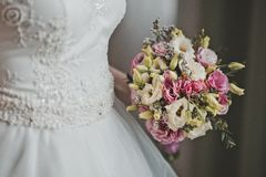 The girl holds a bunch of flowers 2748. Stock Image