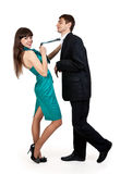 Girl holds a businessman in tie Royalty Free Stock Image
