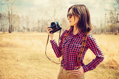 Girl Holds Camera Royalty Free Stock Images