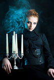 Girl holds a candle stand extinguished candles Royalty Free Stock Images