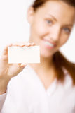 Girl holds a card Royalty Free Stock Image