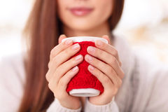 Girl holds the cup in cute cupholder Stock Image