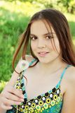 Girl holds dandelion Stock Images