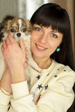 A girl holds a dog in her arms Royalty Free Stock Photos