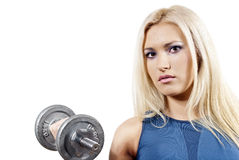 Girl holds a dumbbell Stock Photography
