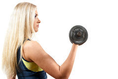 Girl holds a dumbbell Stock Photos