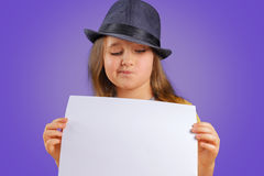 Girl holds empty paper Royalty Free Stock Photo