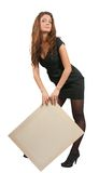 Girl holds an empty poster. Standing long haired girl in holds an empty poster Stock Image