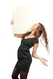 Girl in holds an empty poster. Long-haired girl holds an empty poster. Isolated on white Royalty Free Stock Image