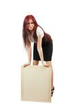 Girl in holds an empty poster. Long haired girl holds an empty poster Royalty Free Stock Photos