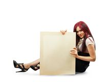 Girl holds an empty poster. Elegance brunette in  black dress with poster  with isolated over white with clipping path Stock Photos