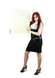 Girl holds an empty poster. Standing long haired girl in holds an empty poster Stock Images