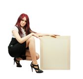 Girl in holds an empty poster. Elegance brunette in little black dress with poster  with isolated over white with clipping path Stock Image