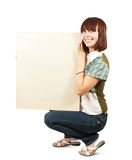 Girl  holds an empty poster. Royalty Free Stock Photography
