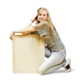 Girl holds empty poster Stock Photo
