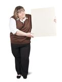 Girl  holds empty poster. Standing big girl holds an empty poster Royalty Free Stock Photos