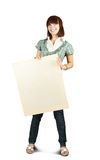Girl in holds an empty poster Stock Images